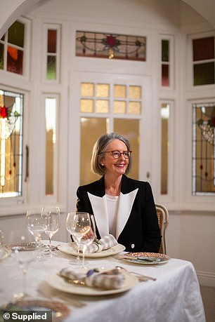 If you want to celebrate the holiday in a classy way, etiquette expert Julie Lamberg-Burnet (pictured) said you should go for one big Easter centrepiece